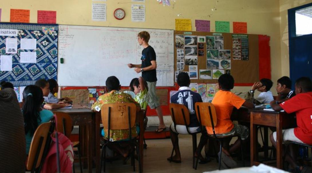 A Teaching Volunteer is leading a Math class for the local children at the Teaching Project in Fiji